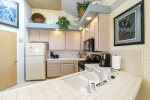The kitchen offers a large counter space for prepping meals and a pantry for food storage