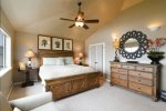 The Master Bedroom has a large dresser, ample closet space and flat-screen TV that is perfectly positioned to watch while in bed.