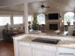 Watch the boats on the bay and the ocean beyond in this beautiful kitchen