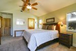 This spacious master bedroom has its own private patio, a TV and a private bathroom with shower.