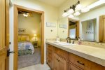 The Jack and Jill  bathroom has a shower and is shared by the twin bedroom and the queen bedroom.