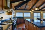The kitchen has granite countertops, lots of space to move around and great views.