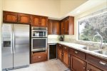 This gourmet kitchen provides everything the gourmet chef could wish for plus a wine refrigerator.
