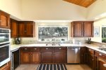 The kitchen was recently remodeled and now has all stainless steel appliances and granite countertops.