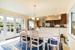 The dining room table will seat up to 8 and the breakfast nook seats 4 and there is an add`l table in the living room. Plenty of seating for all.