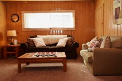 Massey`s River Retreat Cabin- Rustic Exterior ONLY, Inside Cute Cute Cute...On the River, Ranch Style, NO STAIRS, In town and Secluded,  W/D, Wifi, Wood Fireplace, Foose ball Table, Great Parking for ATV`s Trailers, Several Cars , Cowboy Fire Pit