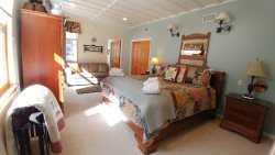 Sleepy River Suite - River View, Hot Tub, King bed, Private Bath w/ Steam Shower, On the River, In Town, Free Wi-Fi, Pet Friendly
