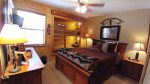 Rustic Retreat Upstairs Queen & Twin Bunks Bedroom