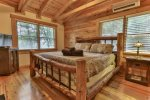 Custom King log bed in the master suite on the upper level