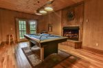 Play a game of pool with the crackling of the gas fireplace