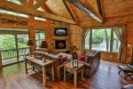 Great room with TV, fireplace and river views