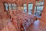 Lull yourself to sleep every night in this queen swinging bed with private deck access