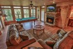 Living area with 50 inch TV and beautiful stone fireplace with pool table and gorgeous views