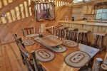 Enjoy a family meal at this beautifully crafted wood table with seating for 6