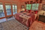 Tastefully decorated master bedroom on main level.  King bed, 32 inch flat screen TV, electric fireplace and private deck access