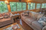 Family room with surrounding windows - great seasonal views of the mountains.