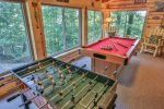Game room on Main with pool table and foosball.
