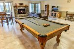 Game room with pool table and fire place