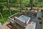 Hot tub on main level with additional seating and river views