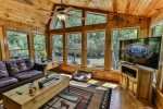 Living room with floor to ceiling windows, overlooking the Cartecay River.