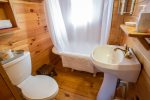 Shared bath with claw foot tub/shower combo on main level