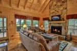 Open living room with wood burning fireplace