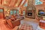 Large open living room with wood burning fireplace