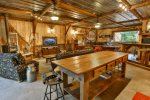 Game barn located on property with pool table and TV