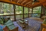 Seating and dinning on screened in porch