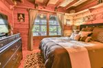 Queen bedroom on main level with mountain views