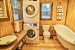 Bathroom with washer/dryer and clawfoot tub