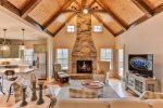 Farmhouse living area - gas stack stone fireplace