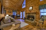 cozy living room with wood burning fireplace