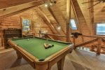 Play a game of pool in the loft  area