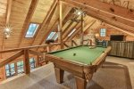 Pool table area opens up to the separate loft  living area with a 60 inch flat screen TV