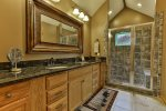 Beautiful master bathroom with a custom tile shower