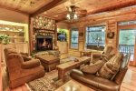 Cozy great room with 50 inch flat screen and wood burning fireplace