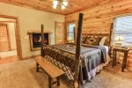 Master bedroom on the main level with king bed, private bathroom and gas fireplace