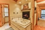 Private master full bathroom with jetted tub, fireplace, and walk in custom steam shower