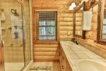 Private master bathroom with custom walk in steam shower, and double vanities