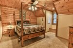 upper leve Queen bedroom has a private custom bathroom