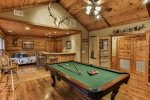 Den with wet bar, pool table and custom stone fireplace
