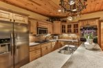 Granite counter tops, under cabinet lighting in the well appointed kitchen