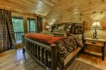 king master bedroom with private bathroom 41 inch TV and access to the deck