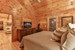 King master bedroom on the main level with 40 inch TV private bathroom and deck access