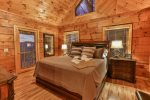 King master bedroom on the main level with private deck access