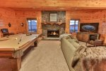 Great room with pool table, TV and wood burning fireplace