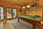 Terrace level game area with pool table and doors leading to the terrace level hot tub