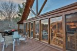 Main level deck custom windows from floor to ceiling never miss the view weather you are inside or out