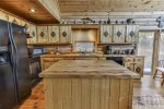 Fully furnished kitchen on the main level with custom wood top island